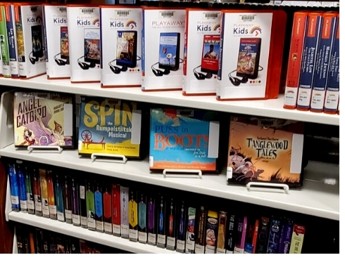 photo of kids materials on library shelves